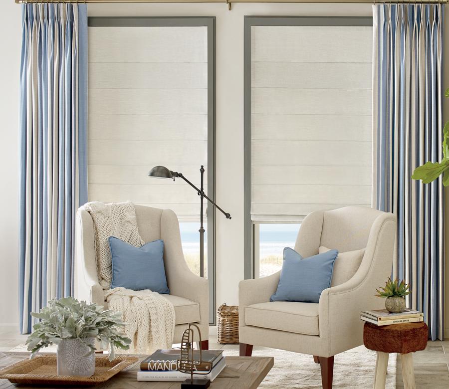 layered custom window treatments drapery panels with white knife pleat roman shades San Antonio TX