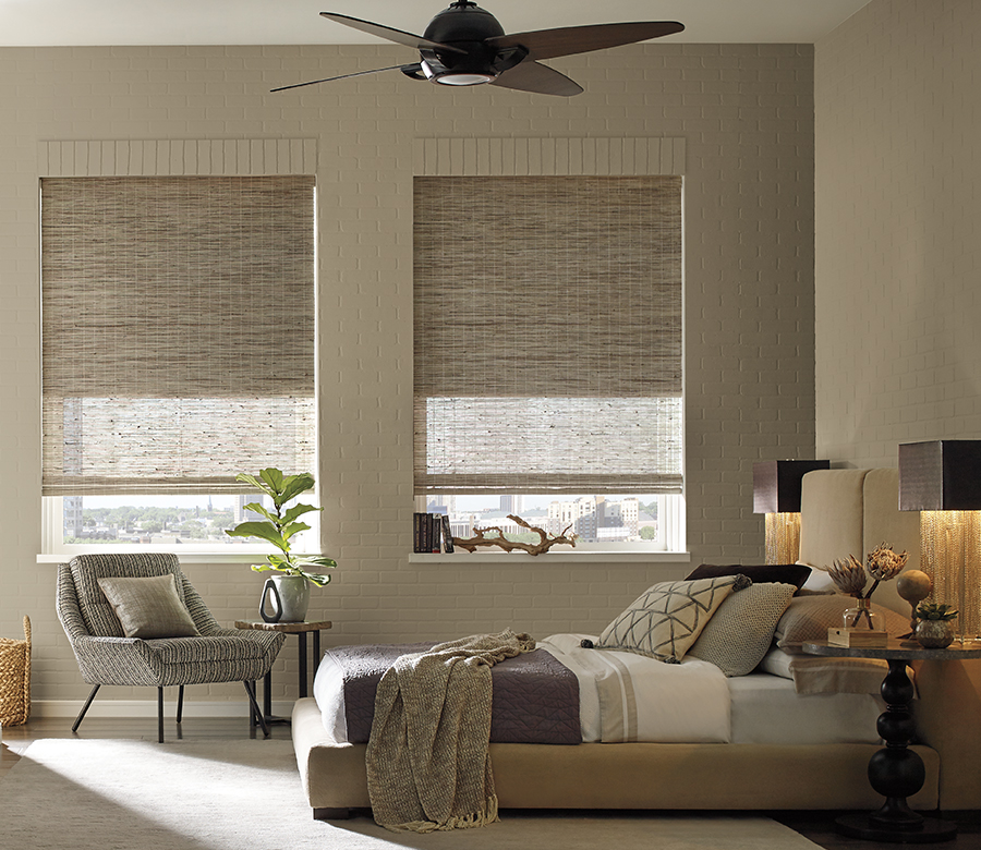 contemporary bedroom with neutral woven wood shades in San Antonio TX