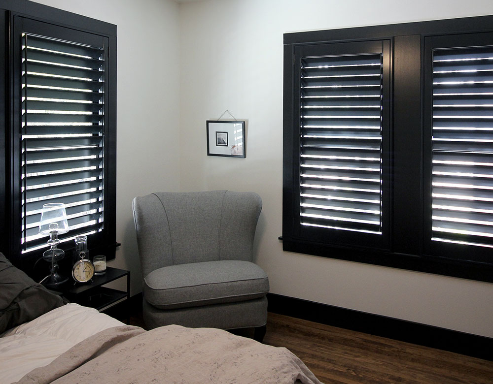 dark walnut stain window shutters in bedroom San Antonio TX