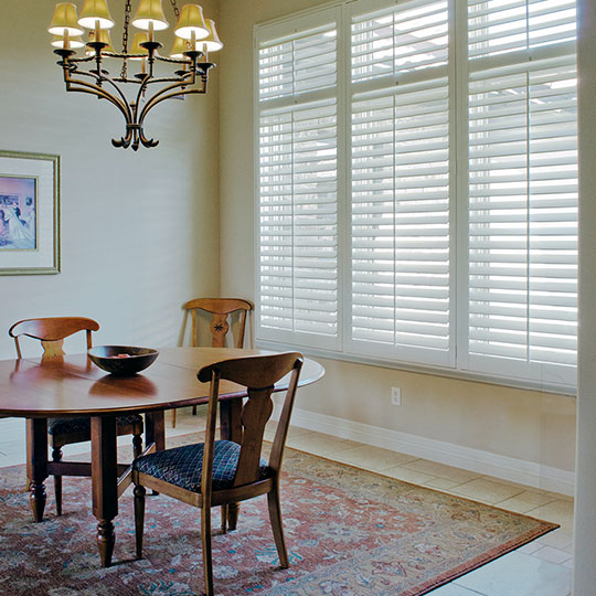 dining room with white interior shutters San Antonio TX