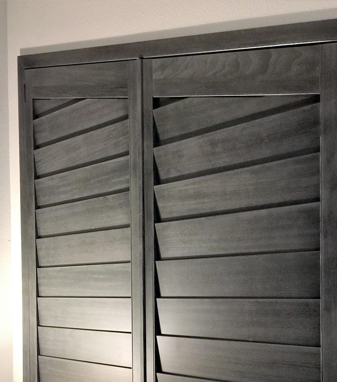 gray stained shutters for angled windows in bedroom as room darkening shutters in San Antonio TX