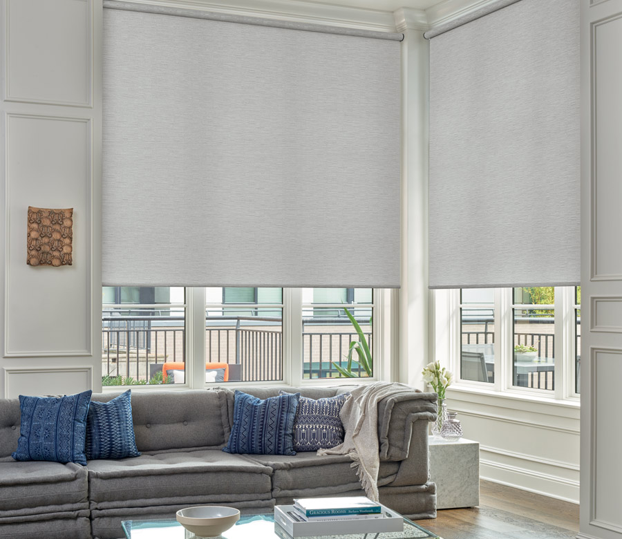 large windows with roller shades in living room of San Antonio Home