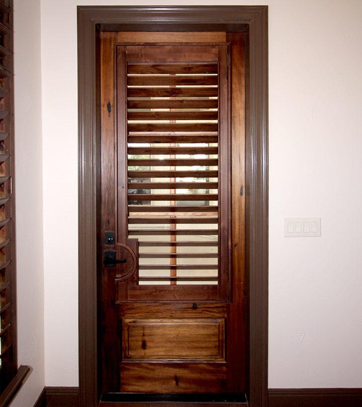 knotty alder wood shutters covering glass door in San Antonio TX