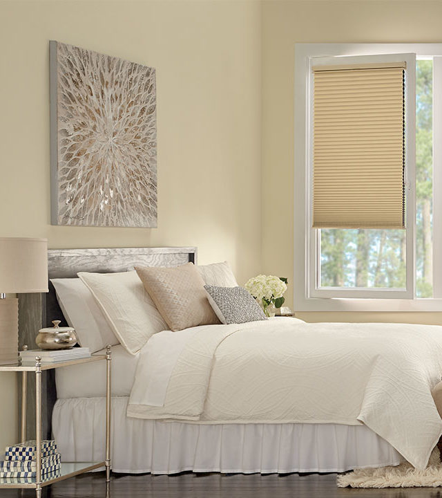 bedroom with tilt turn windows covered with honeycomb shades in San Antonio TX