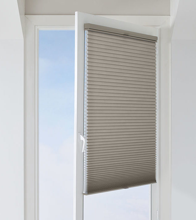 patio door glass windows covered with honeycomb shades in San Antonio TX