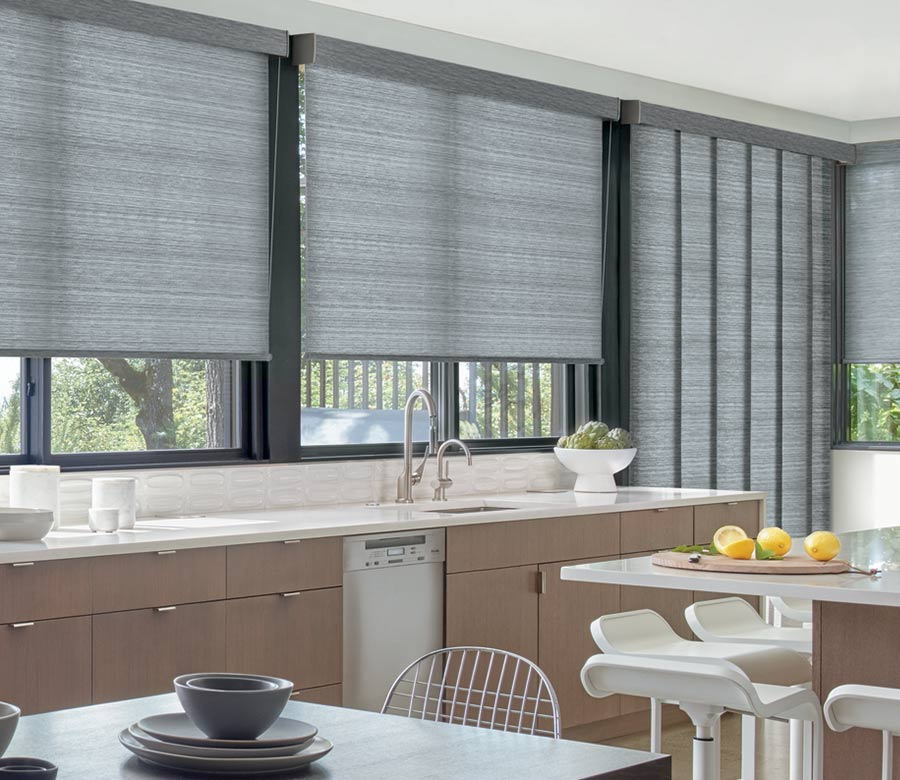 gray roller shades in kitchen with gray panel track blinds on sliding doors in San Antonio