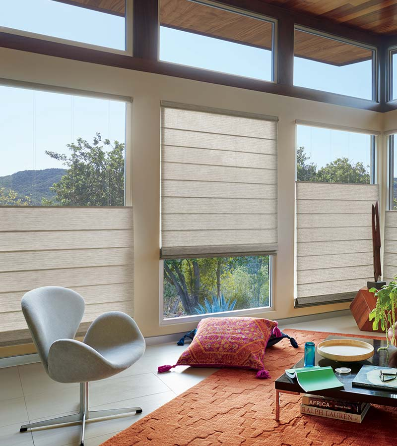 woven textures roman shades covering main parts of the windows in San Antonio TX home