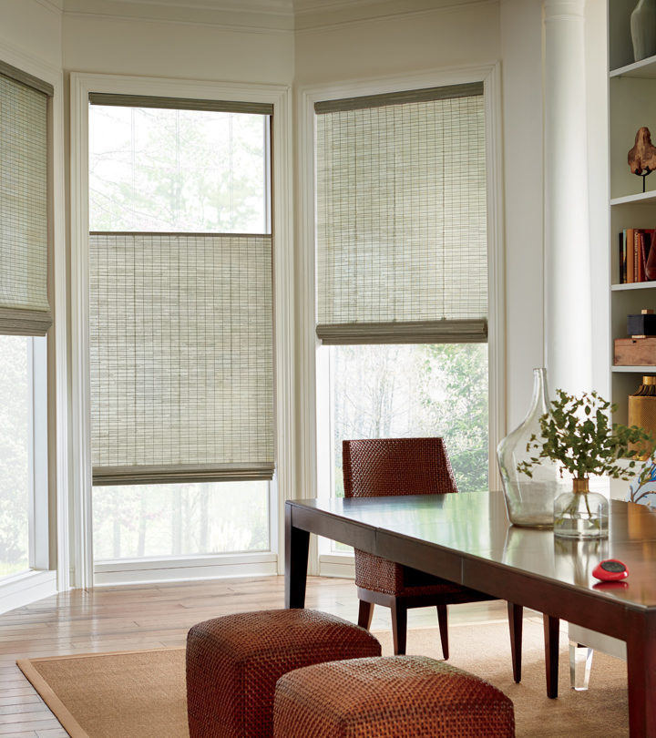dining room with bay window nook covered with woven wood shades