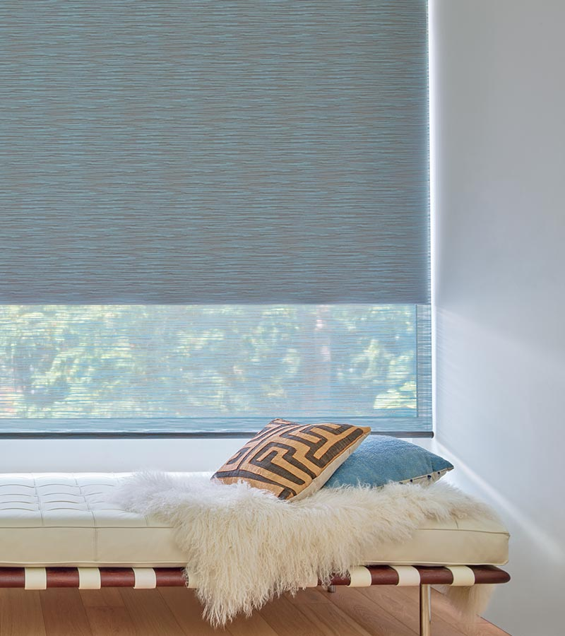 contemporary blue fabric roller shade with dual opacity