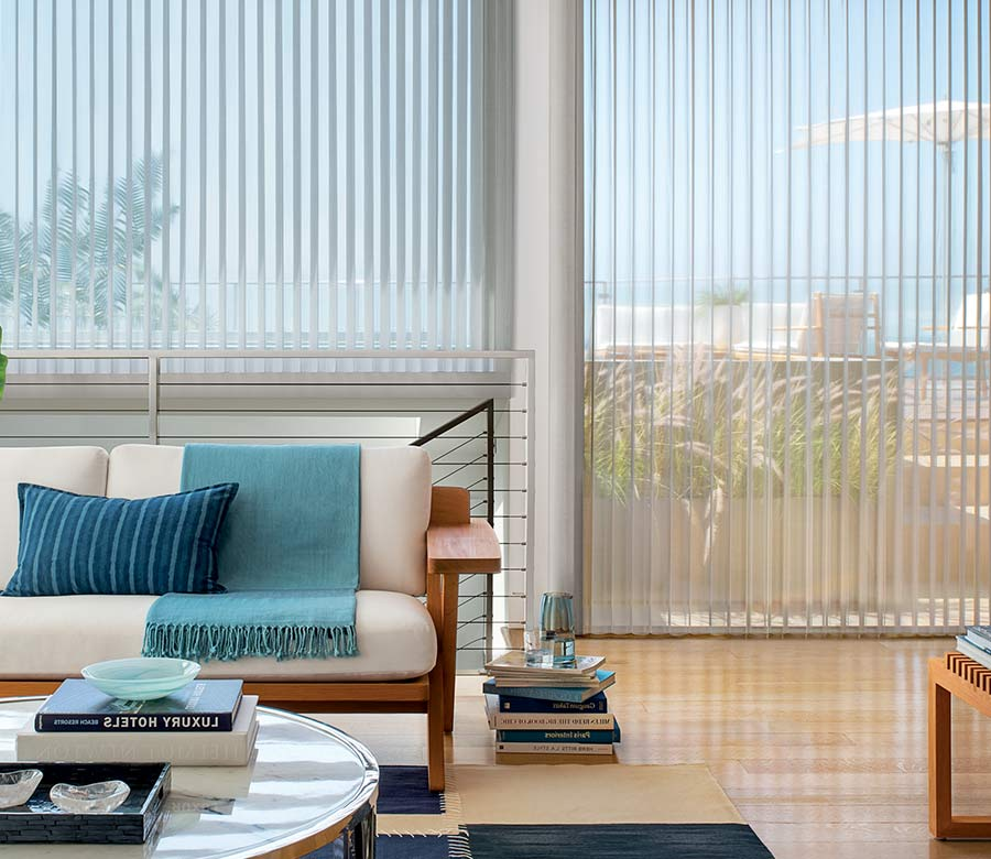 coastal inspired home with floor to ceiling large window shades