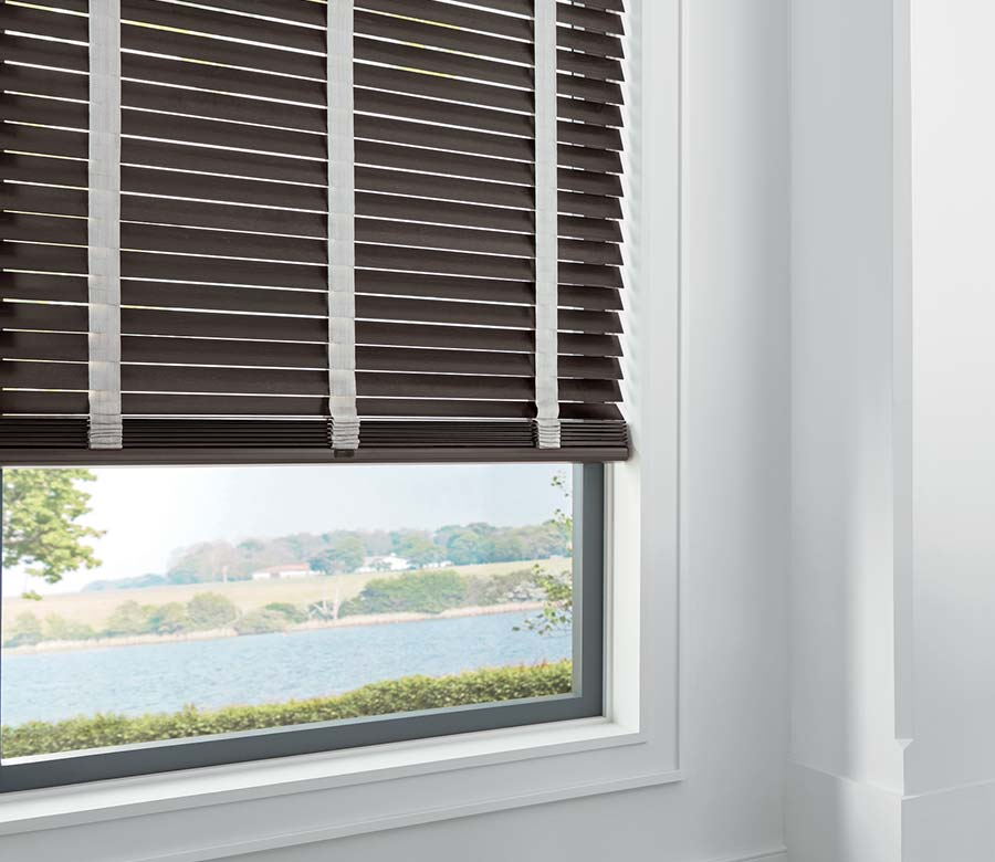 chestnut colored wood blinds in living room