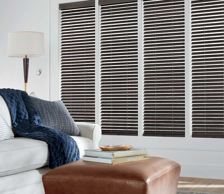 white living room with brown wooden shades